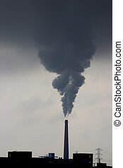 Pollution - A smokestack belches pollution from a power...