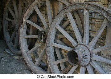 Old wooden wheels - Old wagon wheel with spokes