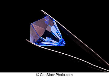 Gem - Tweezers Holding a Gem