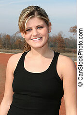 Athletic Teen Woman - Young woman in black tank top outside...