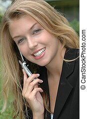 Business Woman - Business woman using cellphone