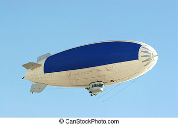 blue copy on blimp - blimp flying in clear blue sky with...