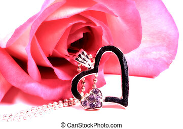 Heart Pendant and a Pink Rose