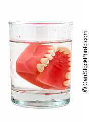Teeth in Glass - Photo of Teeth in a Glass
