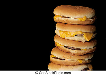 tower of burgers - cheeseburgers arranged in a stack with...