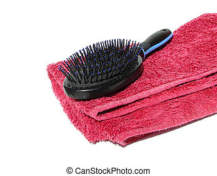 hairbrush on towel