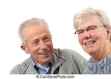 Older couple having fun - Attractive elderly couple having...