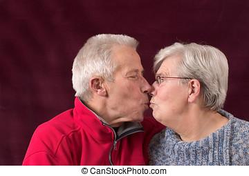 Kissing older couple