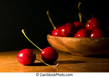 Cherries on a wood table