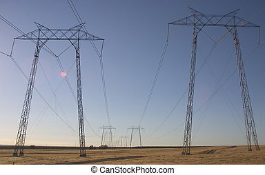 Power Towers - Hight voltage lines are held aloft by giant...