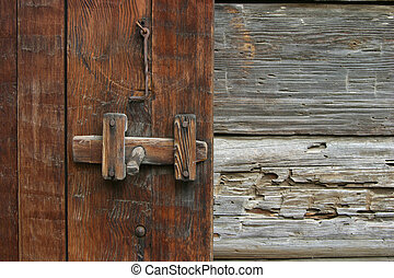 Rustic Door Latch - A very old and rustic door latch on an...