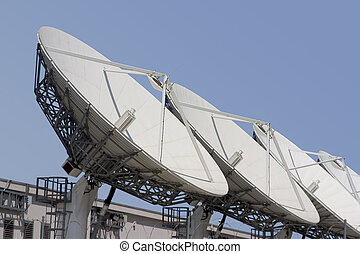 Satellite Dish 1 - A group of satellite dishes point skyward...