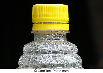 Water bottle with yellow cap on black background