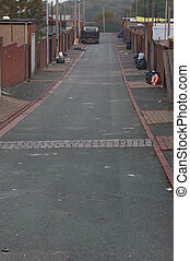 Back Alley 01 - A back alley between two rows of terraced...