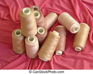 White Pinkish Spools - Spools of White-Pinkish Threads