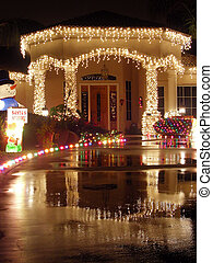 Entry Reflections - Christmas lit entryway reflected in wet...