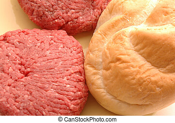 hamburger patties with bun - hamburger patties raw with bun