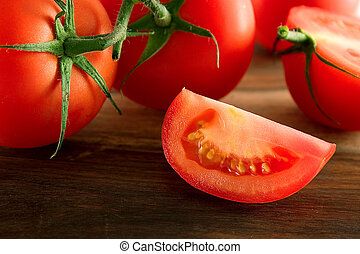 Tomatoes - Fresh tomatoes, close-up of tomato slice