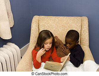 Story Time 2 - Two small children reading together in a big...