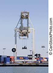 Crane 1 - A large cargo crane is poised to unload another...