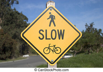 Slow Sign - A traffic sign warns cars to slow down and look...