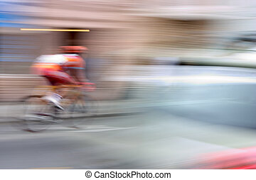 Supersonic Bicycle - A racing bike rider\'s fast speed is...