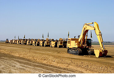 Earth Movers on Parade. - A parade of giant earth-movers are...