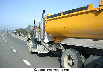 Freeway Truck - A truck drives on the freeway.