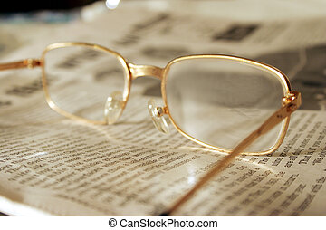 Focus on Evening News - Reading Glasses on the evening...