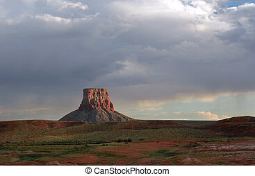 Navajo Butte - Butte sticks up alone with storm on Lake...