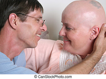 Loving Touch - A cancer patient and her husband sharing a...