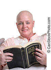 Bible Comfort - A medical patient smiling as she reads the...