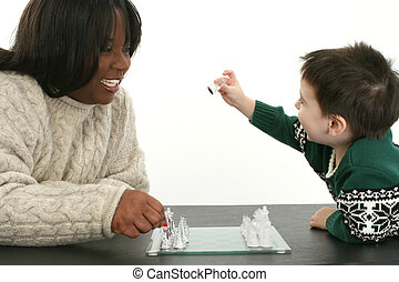 Chess Game - Beautiful African American Woman and two year...
