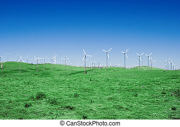 Windfarm 4 - A group of windmills on rolling hills in...