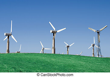 Windfarm 3 - A group of windmills on rolling hills in...