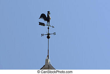 Wind Vane - A rooster wind vane shows the flow.