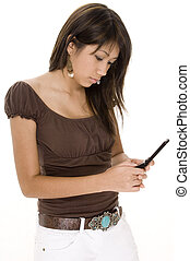 Messaging - A pretty young woman uses her mobile phone to...