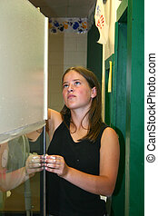 Girl Cleaning Glass - Beautiful young girl cleaning glass on...