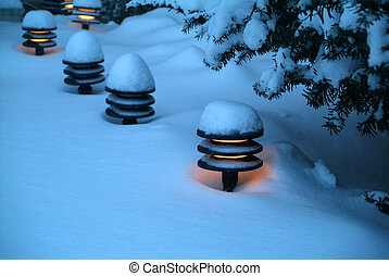 Fresh Snow - Fresh snow on a row of porch pot-lights