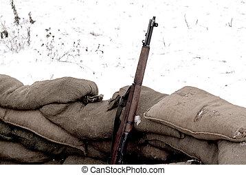Rifle - rifle and sandbags