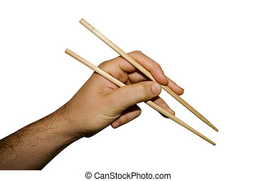 Chopsticks - A hand using chopsticks isolated on white...