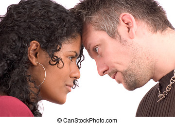 Looking each other in the eye - Pretty diverse couple heads...