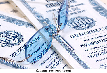 Investments - Eyeglasses and Bond Certificates