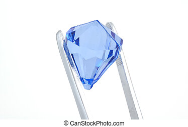 Blue Diamond - Tweezers Holding a Blue Diamond