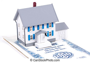 Home Mortgage - Miniature House on a Mortgage Bond