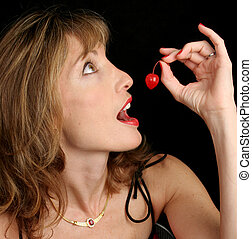 Beautiful Woman Holding Cherry - A beautiful woman holding a...