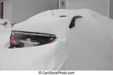 Snow covered auto in drift.