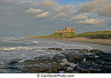 Sentinel - Bamburgh Castle, reflecting a stormy sunset.