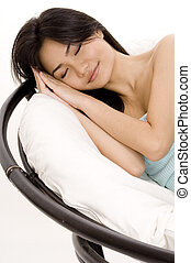 Afternoon Nap - A pretty young asian woman takes a nap in a...