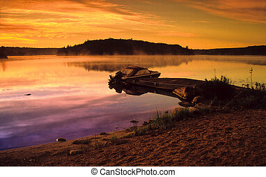 Motorboat on a lake. - Motorboat on a small lake.